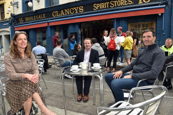 Paul Montgomery (right) proprietor with Erin O'Brien and Brian Geaney enjoy a drink and food at Clancy's on Princess street, Cork Picture: Eddie O'Hare