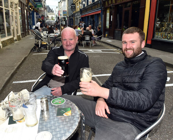 Barry and Alex O'Connor enjoy a drink and food at Clancy's on Princess street, Cork Picture: Eddie O'Hare