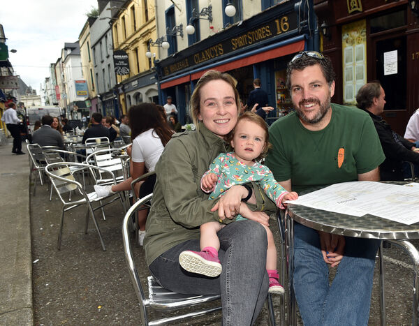 Reg and Grace Connolly and their daughter Matilda from High street getting ready to order a drink and food at Clancy's on Princess street, Cork Picture: Eddie O'Hare