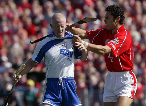 John Mullane of Waterford and Seán Óg, Cork wing-back, battling in the 2004 Munster final. Picture: INPHO/Lorraine O'Sullivan