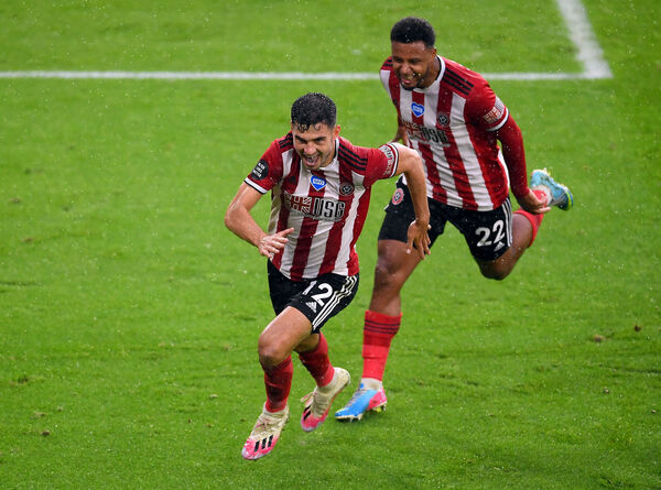 Sheffield United's John Egan celebrates scoring his side's first goal of the game during the Premier League match at Bramall Lane, Sheffield. PA Photo.