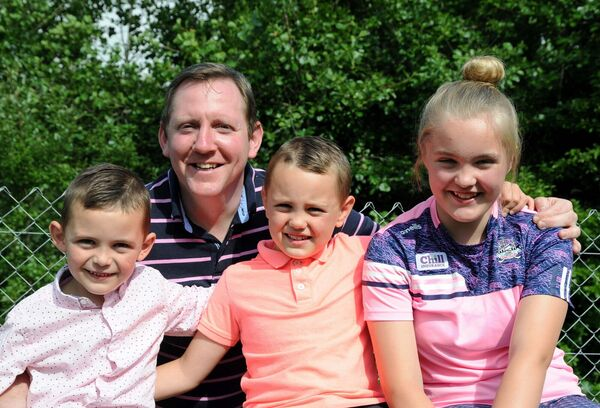 Denis Collins with his children Éabha, Johnny and Rory at home in West Cork.Picture Denis Minihane.