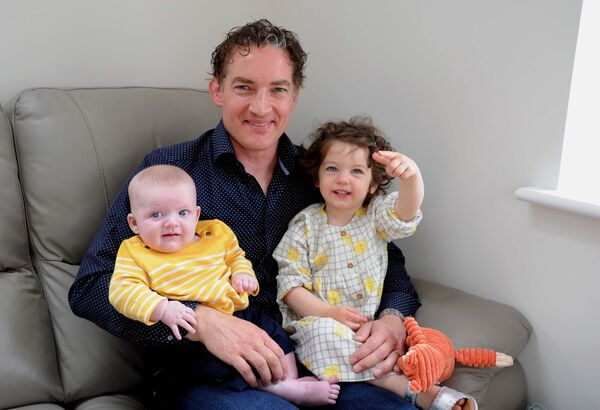 Tadhg O'Leary at home with his children Eve and Finn.Picture Denis Minihane.