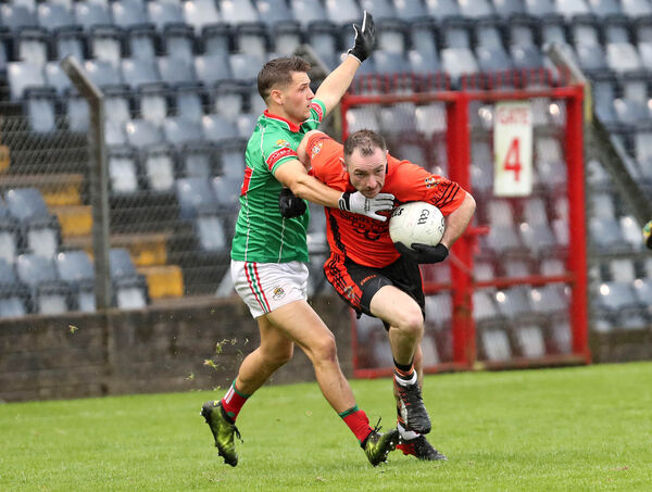 Donncha O'Connor, Duhallow, takes on Eoghan Deasy, Clonakilty. Picture: Jim Coughlan.