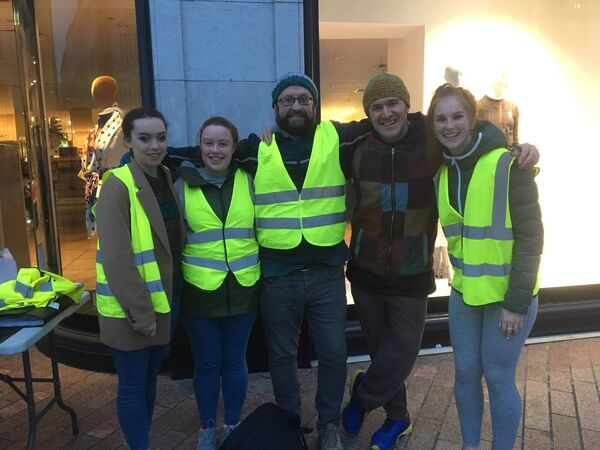 Colm Healy, centre, now works with volunteers for the homeless and is planning on studying Criminology. Here he is pictured with volunteers who set up Cork Stand Together, who help the homeless.