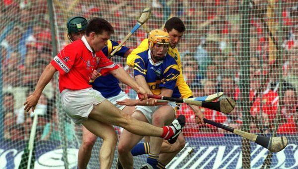 Cork forward Alan Browne kicks goalwards while challenged by Tipperary's Brendan Cummins and Paul Ormonde. Picture: Des Barry