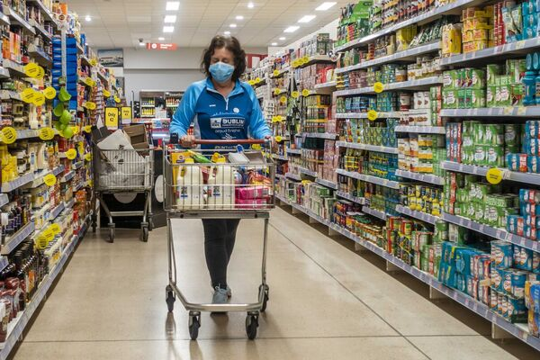 A woman wears a face mask to protect herself from Covid-19 as she shops in SuperValu, Clonakilty. Picture: Andy Gibson