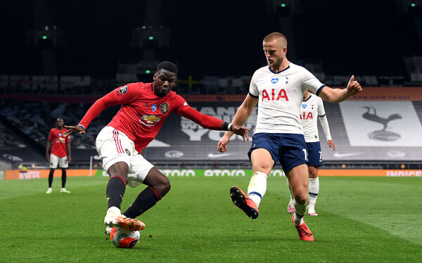 Manchester United's Paul Pogba and Tottenham Hotspur's Eric Dier battle for the ball last Friday night. Picture: Shaun Botterill/PA Wire/NMC Pool.