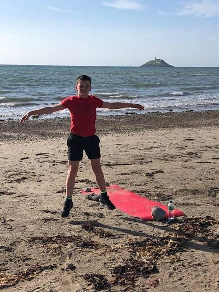 Dylan Gunn, Sunday's Well, completing his Dryland Training before his swim at Garryvoe Beach.