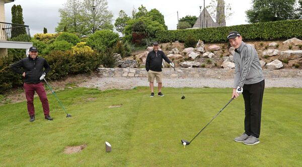 Rob Lucey, Alan and Adam Harrington on the 15th tee at Cork Golf Club. Picture: Jim Coughlan.