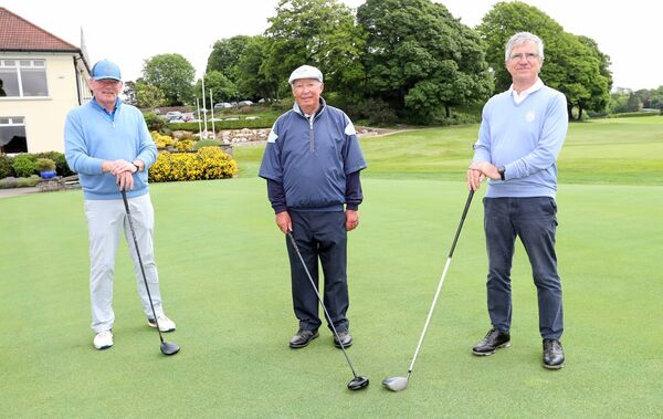 Liam Murphy, Willie Weir and Sean O'Breasail, all Cork Golf Club, after their round. Picture: Jim Coughlan.