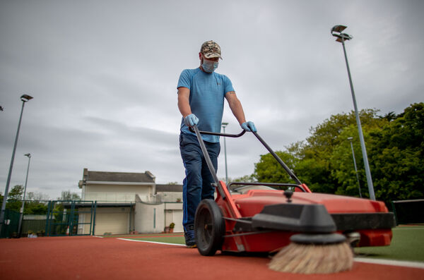 Ronan Troy, a volunteer with Shankill Tennis Club, prepared the courts ahead of its re-opening. Picture: INPHO/Morgan Treacy