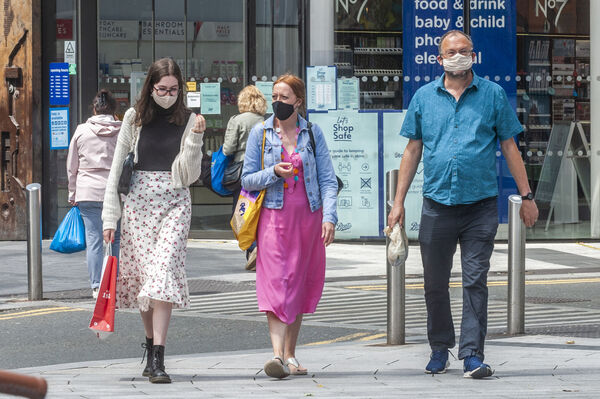 People wear face masks in Cork city to protect themselves from Covid-19. Picture: Andy Gibson