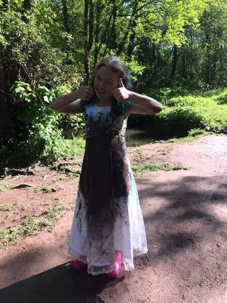 Lucy's dress was a little worse for wear after she rolled down a hill and played in some mud in a woods near her house.