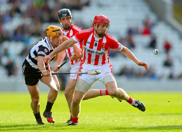 Imokilly's Bill Cooper with Paul Haughney of Midleton. Picture: INPHO/Oisin Keniry