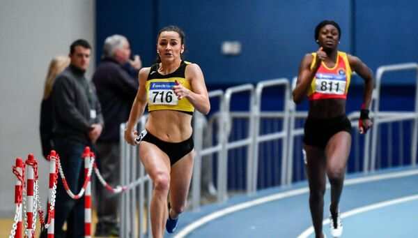 Phil Healy of Bandon AC, Cork, left, on her way to winning the Senior Women's 200m event during day one of the Irish Life Health National Senior Indoor Athletics Championships. Picture: Sam Barnes/Sportsfile