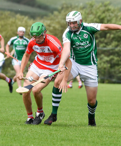 Ballincollig's Ciaran O'Sullivan battling with Courcey Rovers' Tadhg O'Sullivan, during their Cork PIHC clash at Brinny. Picture: David Keane.