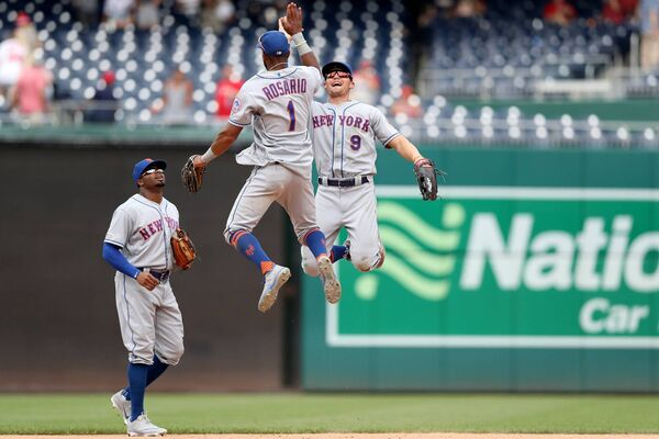 HIGH FIVE: Amed Rosario and Brandon Nimmo of the New York Mets celebrate their win over the Washington Nationals last season. Picture: Rob Carr/Getty Images