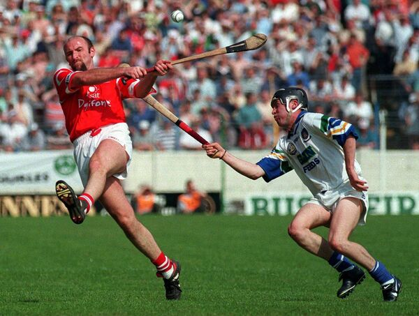 Brian Corcoran of Cork in action against Dave Bennett of Waterford during the 1998 National Hurling League final at Semple Stadium in Thurles. Picture: Damien Eagers/SPORTSFILE