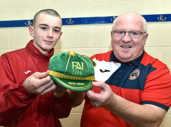 Peter Connolly, CSL chairman, presenting Corinthian Boys' Liam Murray his Ireland U15 cap. Picture: Eddie O'Hare