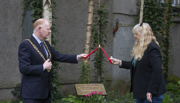 The Lord Mayor of Cork , Cllr. John Sheehan lighting a candle with Fiona Corcoran, founder of the  Chernobyl Greater Cause at the short remembrance ceremony to mark  the 34th anniversary of The Chernobyl Disaster at Bishop Lucey Park, Cork. Picture Dan LInehan
