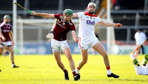 Galway's Brian Concannon and Tim O'Mahony of Cork. Picture: INPHO/Ryan Byrne