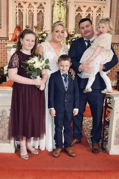 The couple with their three children, Amy aged 10, Ryan aged seven adn Alice aged 2.