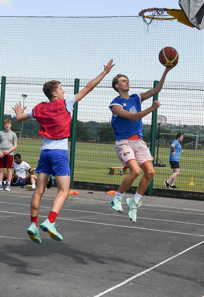 Jamie Cotter and Sean Barrett, in action during the Shooting Stars basketball camp. Picture: David Keane.