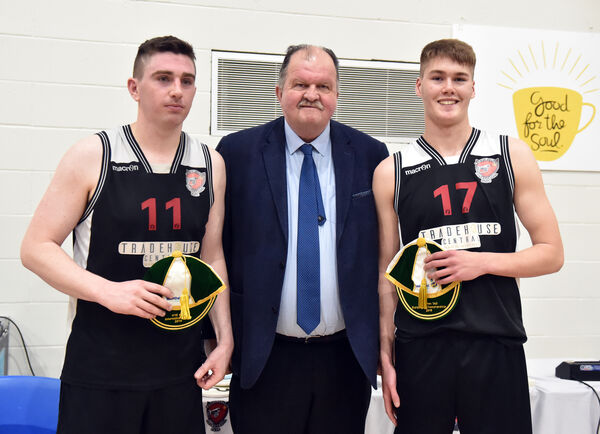 Bernard O'Byrne, CEO Basketball Ireland, presented international caps to Tradehouse Central Ballincollig players Ciarán O'Sullivan and Andrew O'Connor. Picture: Eddie O'Hare