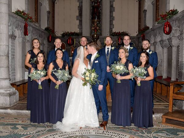 The happy couple at the Honan Chapel with their wedding party.