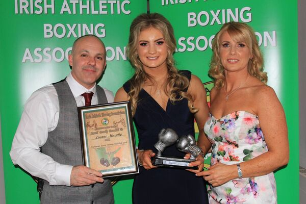 Leanne Murphy, Togher BC with her coaches Sean and Louise Forde after winning her boxing award