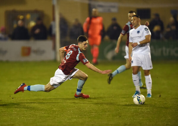Cobh Ramblers' Pierce Philips wins the ball from Drogheda United's Chris Lyons. Picture: Eddie O'Hare