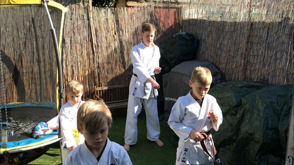 Children doing virtual karate training during lockdown. Picture: PA Photo.