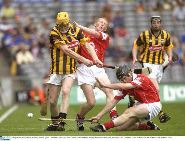 Richie Power, Kilkenny, is blocked down by Shane O'Neill in the 2003 minor clash. Picture: Ray McManus/SPORTSFILE