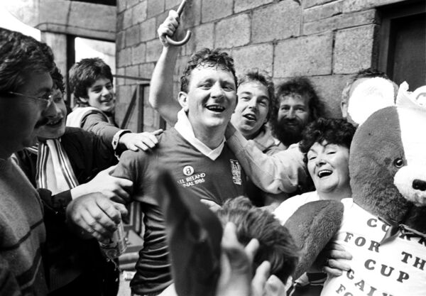 Johnny Crowley is mobbed by supporters after Cork beat Galway in 1986.