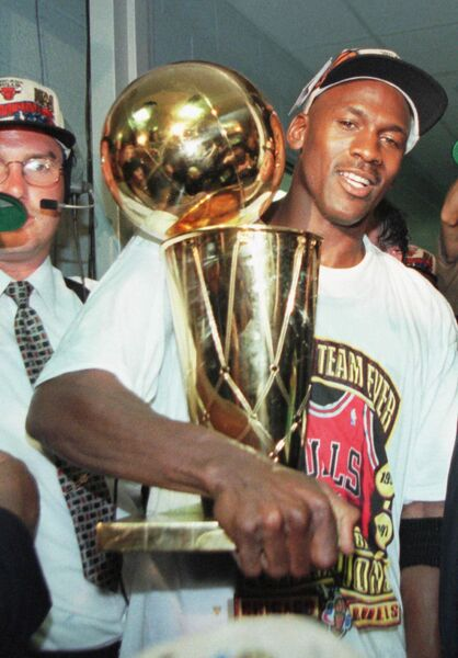 Chicago Bulls' Michael Jordan holds the NBA Championship trophy after the Bulls beat the Seattle SuperSonics 87-75 Sunday, June 16, 1996, in Chicago to win their fourth NBA Championship.	 Picture: AP Photo/Beth A. Keise