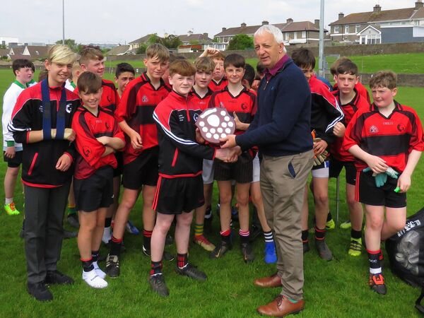 Conor Counihan presented the Imokilly Shield to the winners Glanmire Community College.