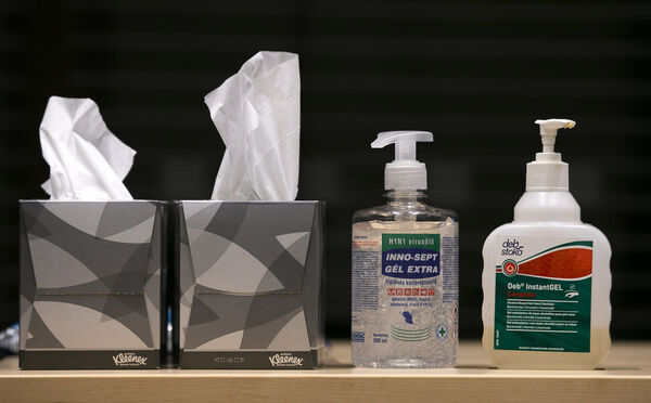 Pictured hand sanitizers at a press conference on COVID-19 Coronavirus