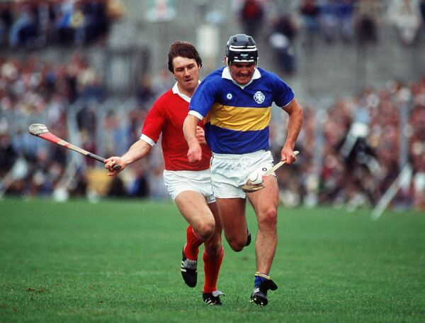 Liam Maher attacks for Tipp, chased by Cork's Tom Cashman in the 1984 Munster final. Picture: INPHO/Billy Stickland