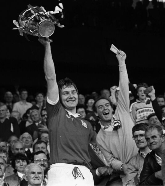 Tom Cashman lifts the Liam McCarthy Cup after Cork's All-Ireland final win over Galway in 1986.