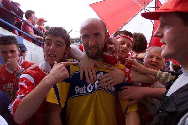 Brian Corcoran is surrounded by fans after beating Clare in 1999. Picture: Kieran Clancy