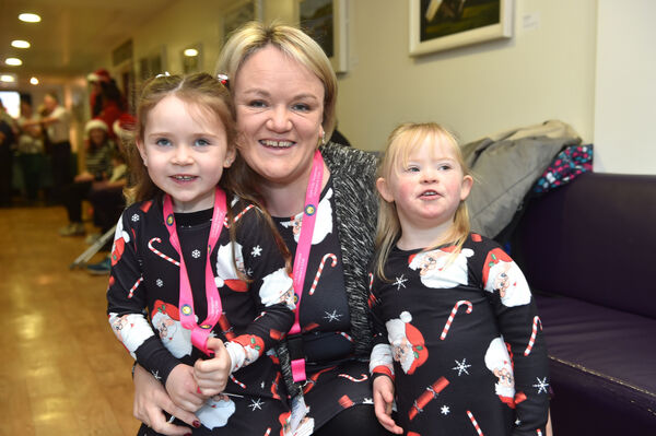 Susan O'Sullivan, Tower with her daughters Ciara Jane and Aoife at Cork University Hospital for the annual Cork City Hospitals Children's Club annual Christmas day out to the magical winter wonderland at Fota House. Picture Dan Linehan