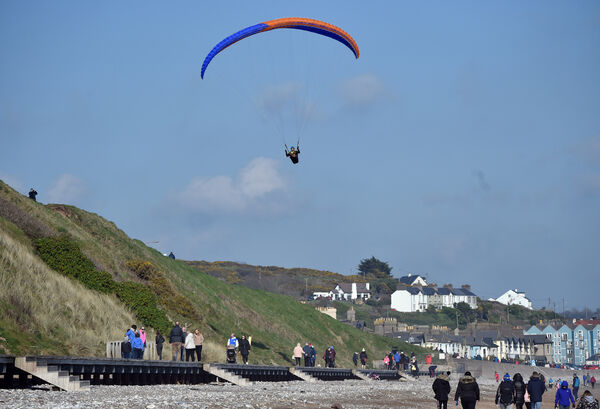 A powered parachue hovering over the beach in Youghal.Picture: Eddie O'Hare