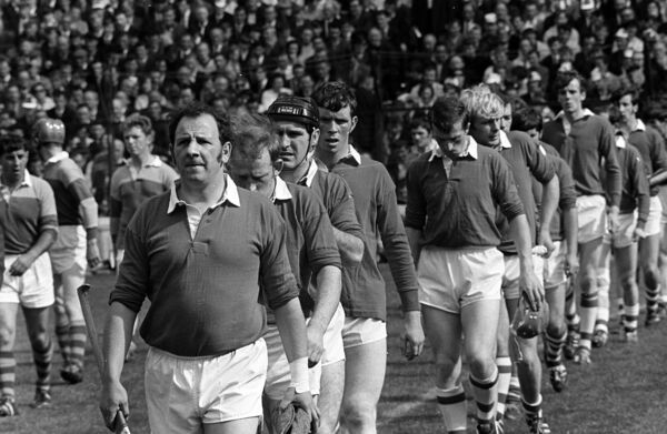 Paddy Barry leads the Cork team out against Wexford in 1970.