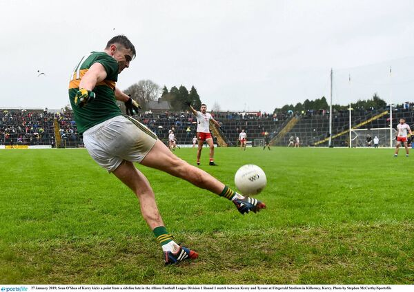 Seán O'Shea of Kerry kicks a point from a sideline. Picture: Stephen McCarthy/Sportsfile