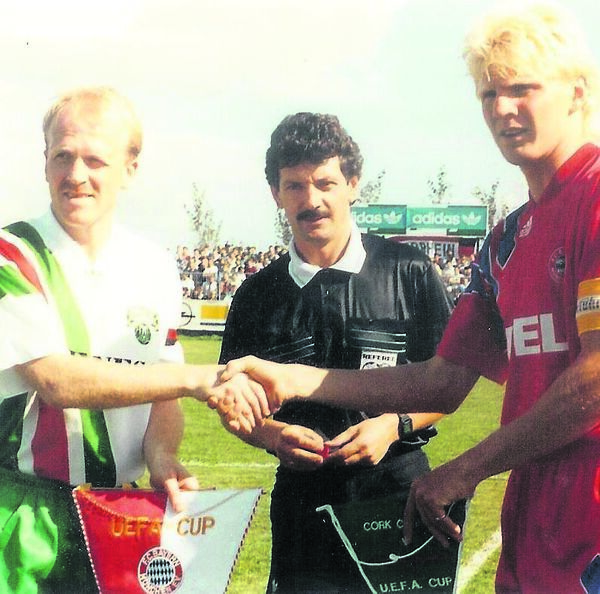 Liam Murphy was honoured in February 1984 for his sterling displays with Limerick. Here he's exchanging pennants for Cork City with Stefan Effenberg (Bayern Munich).