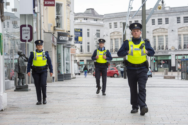 As the new Coronavirus Covid-19 regulations come into effect the Gardai have a presence on the streets of Cork today. Picture Dan Linehan