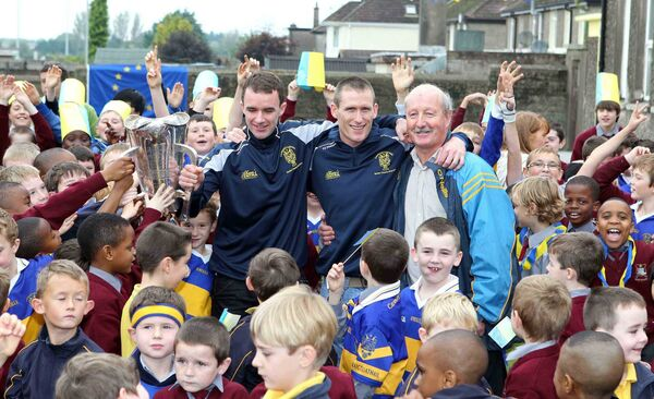 Brian Lordan and Noel Furlong with Ger Foley, hurling teacher, at Scoil Mhuire Naofa. Picture: Jim Coughlan.