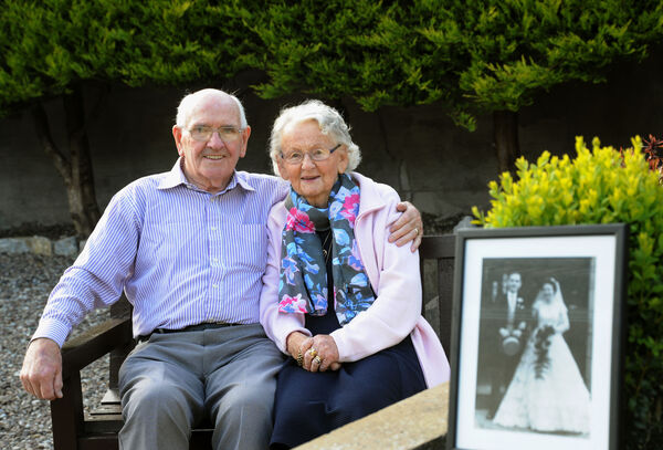 Donal and Norma Murphy, Ballincollig, who are celebrating their diamond wedding anniversary, with their wedding photograph from the Lough Church on the right.Picture Denis Minihane.
