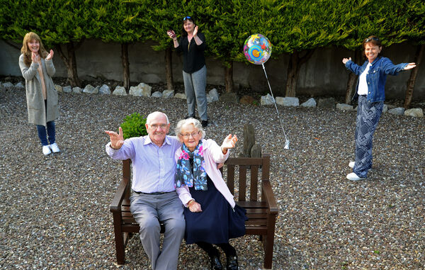 Donal and Norma Murphy, Ballincollig, celebrating their diamond wedding anniversary with their daughters (from left) Orla, Mary Anne and Fionnuala while keeping their social distance.Picture Denis Minihane.